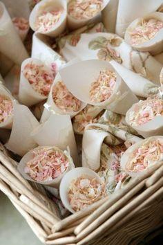 Flower petal cones for outdoor wedding ceremonies.