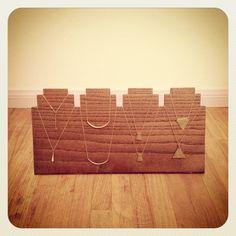 Handmade wood necklace display board.