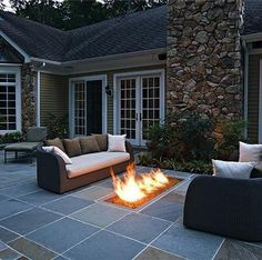 In-ground fire pit. Only I would want a round one.
