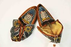 A pair of early bead tapestry Native American Moccasins