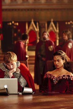 Bored, at the round table, Merlin can't do anything right. Good god why is Gwen still staring at me....