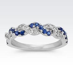 This gorgeous ring features a braided twist of 15 round sapphires (approx. .34 carat TW) and 15 round diamonds (approx. .26 carat TW). As the two pavé-set gemstones intermix together, they reflect off each other and create intriguing sparkle and brilliance. The beautiful ring is crafted of quality 14 karat white gold and has a total gem weight of approximately .60 carat.