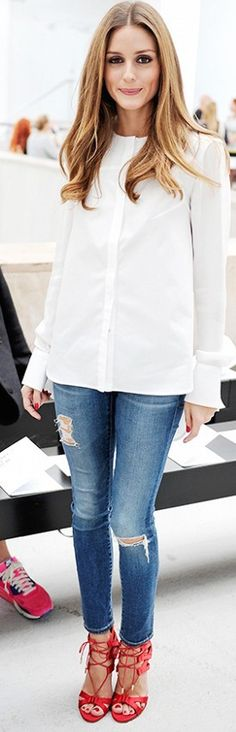 Olivia Palermo in a white blouse, ripped skinny jeans, and red lace-up heels