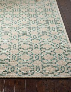 Boasting a classic lattice pattern and hand-knotted construction, the Largo Knotted Area Rug is designed to bring beauty to your home for years to come.
