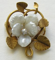 Art Nouveau brooch features a pansy made from five freshwater pearls accented with a diamond center.