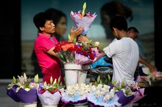Street vendors prepare bouquets in Shanghai for the Qixi Festival, or the Chinese Valentine's Day, which falls today.
