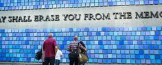 Visitors stop and reflect in front of the Virgil quote at the 9/11 Memorial Museum.