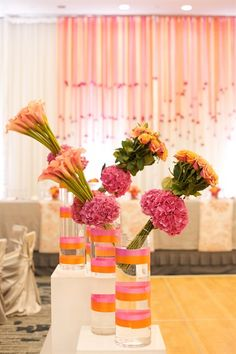 orange calla lillies and roses sit in bouquet style as table decor for the reception