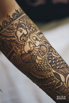 Real Indian Weddings - | Viren and Nupur | WedMeGood | Bridal Hand Mehendi with Ganpati Design  #wedmegood #mehendi #ganpati
