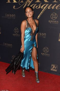Slinky: The stunning singer, 35, looked ready for the bedroom as she worked the red carpet in a skimpy negligee-style dress at the Karma Masquerade event at The Liaison Lounge in Hollywood