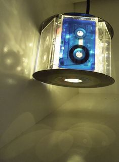 Such a cool lamp! Put those old cassettes to use! ha