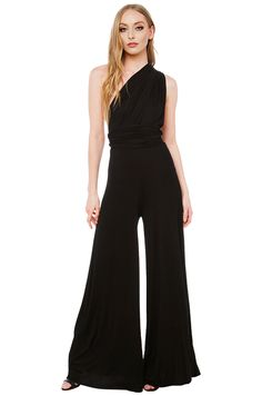 AKIRA's Jersey Multi Function Black Jumpsuit features a sleek body with raw hem detail, banded waist, and flowing long legs; a plunging neckline on a halter-style top with extended straps. Free standard U.S. shipping $75+.