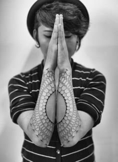 Amazing line work on these forearm tattoos. Almost looks like honeycomb.