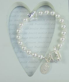 Another classic bracelet using freshwater Pearls with hammered square puffy bead & matching square toggle clasp, both in fine 97-99% silver from the famous Karen Hill Tribes, all other silver used is 925 sterling.