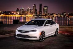 2015 Chrysler 200. Pearl white exterior and black interior? Blacked out windows...