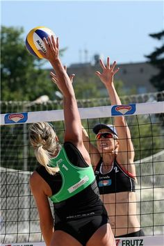 Indre Sorokaite of Italy (left) and Kimberly Dicello of USA duel at the net