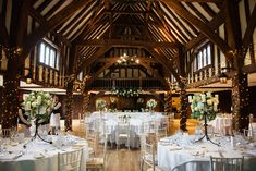Great Fosters Tithe Barn decorated for a July wedding. Barn Wedding Decorations, Table Decorations, Great Fosters, July Wedding, Best Wedding Photographers, Surrey, Luxury Wedding, Barns, White Flowers