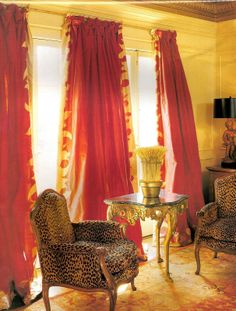 Love the curtains and animal print on the french chairs