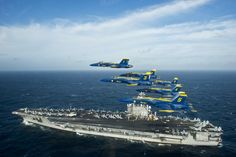 ATLANTIC OCEAN (Dec. 10, 2014) The U.S. Navy flight demonstration squadron, the Blue Angels, fly in the Delta Formation over the aircraft carrier USS George H.W. Bush (CVN 77) off the Florida coast near Mayport Naval Station. (U.S. Navy photo by Mass Communication Specialist 1st Class Terrence Siren/Released)