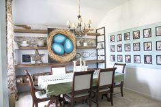"""love the shelving - but I would try to make them """"floating"""" or paint the black shelf holders white to match the walls....love the old barnwood look though"""
