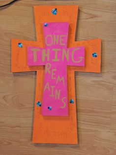 One Thing Remains (Mom's birthday present) cross by HumanRadio. It was originally going to be all orange with a little bit of blue but I was scared I didn't have enough orange paint so I did orange and pink for the main colors (her favorite color is pink!) I plan to do more cross designs for a possible shop/store where i can sell art like this... This is based on the song One Thing Remains by Passion featuring Kristian Stanfill ( https://www.youtube.com/watch?v=GoYgi0sdOqc )
