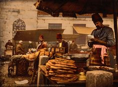 A photochrome print of a cook working a storefront in Istanbul, Turkey, c.1895