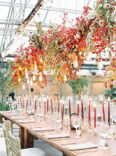 Colorful Autumn Wedding In Philadelphia ~ Dramatic and colorful, Sullivan Owen's suspended foliage and floral installation; Lauren Fair Photography