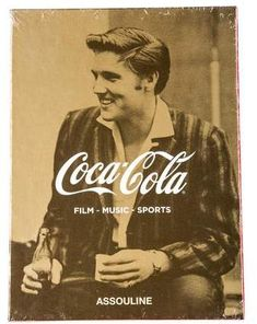Assouline Coca-Cola: Film, Music, Sports Set of three hardcover books published by Assouline as part of their Memoire Collections, Coca-Cola: Film, Music, Sports celebrates the iconic brand's broad-reaching influences in these various domains and includes revered imagery and forwards written by Ridley Scott, Quincy Jones, and LeBron James. Includes decorative slipcase.