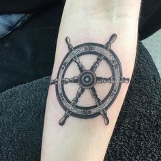 Neat little ships wheel #nauticaltattoo #shipswheeltattoo #blackandgrey…