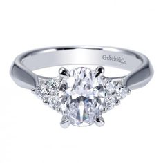 Gabriel & Co. - 14K White Gold 3-Stone Tapered Engagement Ring for an Oval Cut Diamond.