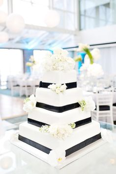 black and white wedding cake with white floral decoration