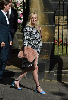 In full bloom: Fearne Cotton looked glowing in a print smock dress which showed off her pregnancy figure to perfection. as she arrived for the wedding of Declan Donnelly and Ali Astall in Newcastle, 1 August 2015
