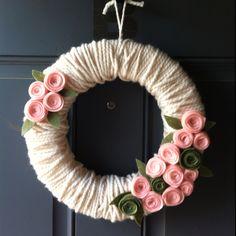 Yarn wreath with felt flowers