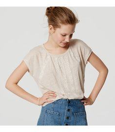 Intricate embroidery and a femme shirred neck intrigue this easy linen tee. Round neck. Cap sleeves. Shirred beneath neckline.