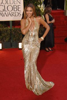Pin for Later: Beyoncé's Style Transformation Proves There's No Rest For the Queen 2007, Golden Globe Awards B vamped it up in a gold sequin Elie Saab dress.