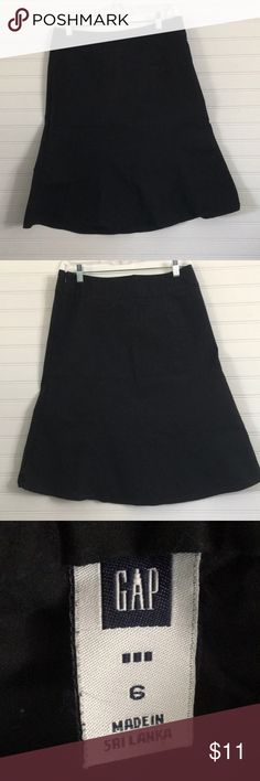 GAP Black Skirt Black midi skirt, slight a-line or flare, simply cut and very flattering to all. Small split in seam next to invisible zipper, that's what you get when you try to wear it if you're not a size 6 anymore! 😜 has a lot of life left and still very black. GAP Skirts Midi