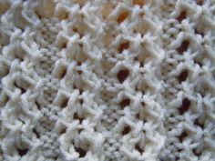 Learn the Open Chain Ribbing Knitting Stitch ; it has some stretch to it. ~ Skill level: Intermediate; 6 Stitch pattern repeat. ~ Multiple of 6 + 2. ~ 1st row (wrong side): K2, *p4, k2; rep from * to end. ~ 2nd row: P2, *k2 tog, [yo] twice, sl 1; k1, psso, p2; rep from * to end. ~ 3rd row: K2, *p1, purl into front of first yo, purl into back of 2nd yo, p1, k2: rep from * to end. ~ 4th row: P2, *yon, sl l, k1, psso, k2tog, yfrn, p2; rep from * to end. ~ Rep these 4 rows.