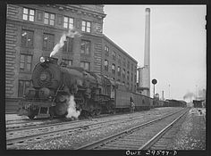 Cleveland, Ohio. A trainload of iron ore at the Pennsylvania Railroad docks waiting to leave for the steel mill area