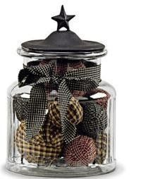 """Black Star Medium Glass Jar by Primitive Home Decors. $26.95. 100% Cotton Fabric. Black Star Medium Glass Jar 7"""" Tall Glass With Metal Lid Priced and sold individually. A decorative glass container with metal lid accented by a black star. This glass container is perfect as a country accent and useful for display"""