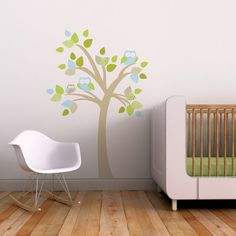 Bring the beauty of nature inside with this modern and playful wall decal featuring two little owls on a tree. This kid friendly wall decal is perfect for the modern nursery or toddler room.