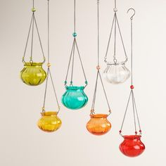Bright and versatile, our tealight holders come in a set of six colors. Each lantern holds one tealight candle and features a small decorative handle for convenient hanging indoors or out.