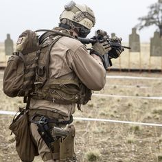 U.S. Marine Cpl. Jake Warden finishes engaging a target during Realistic Urban Training aboard Fort Hunter Liggett, Calif., Dec. 3, 2014. Warden is with the Force Reconnaissance Detachment, which makes up part of the 15th Marine Expeditionary Unit's Maritime Raid Force. RUT prepares the 15th MEU Marines for their upcoming deployment, enhancing their combat skills in environments similar to those they may find in future missions. (U.S. Marine Corps photo by Cpl. Anna Albrecht/Released)