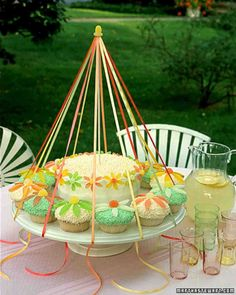 No May Day celebration would be complete without a maypole. A central layer cake anchors the gumdrop-topped pole -- a painted wooden dowel -- which is strung with ribbons and ringed by cupcakes. Seven Minute Frosting, Spring Cupcakes, Flower Cupcakes, Sweet Cupcakes, May Days, Beltane, Baking Cups, Let Them Eat Cake, Cupcake Cakes