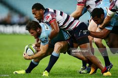 Rob Horne of the Waratahs is tackled during the round 11 Super Rugby match between the Waratahs and the Rebels at ANZ Stadium on April 25, 2015 in Sydney, Australia.