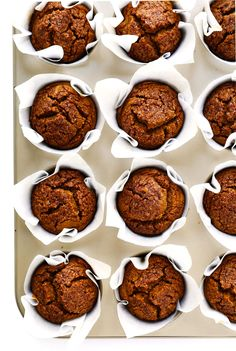 Healthy pumpkin muffins recipe! They're naturally gluten-free, naturally sweetened with maple syrup, easy to make, and SO delicious. Perfect for fall breakfast, dessert, and snacking.