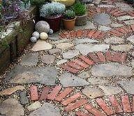 broken brick  path way pictures   Coolest driveway, ever! Mosaic made of broken concrete, stone, bricks ...