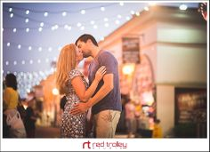Belmont Park engagement photography by Red Trolley Studio, Engagement with market lights, San Diego romantic portrait photographer