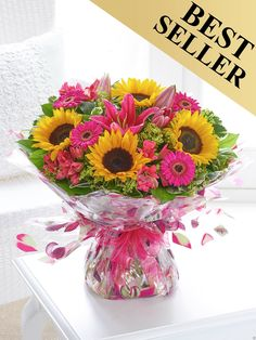 Featuring cerise germini, dark pink LA lily, yellow sunflowers and cerise alstroemeria with green alchemilla mollis, salal and pittosporum, wrapped and trimmed with a cerise voile ribbon and presented in gift packaging. Easter Flowers, Valentines Flowers, Mothers Day Flowers, Christmas Flowers, Send Flowers, Bridal Flowers, Summer Flowers, Best Flower Delivery, Flower Delivery Service