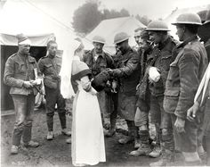 WWI - After being treated for wounds,  the soldiers give the nurse a dog that they found in the trench.