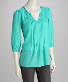 Smatterings of studs add playful whimsy to this pretty top. Airy, lightweight fabric and a chic v-neck silhouette with playful front pleats ensure any ensemble's feminine and fashion-forward.Measurements (size M): 31'' long from high point of shoulder to hem100% polyesterMachine wash; hang dryImported
